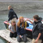 Some of the students are finding marine life beneath the docks at the tide pools.